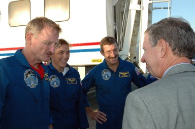 KENNEDY SPACE CENTER, FLA. - NASA Administrator Michael Griffin, right, talks to the STS-115 crew after its return from space. The crew members shown are Mission Specialists Joseph Tanner, Heidemarie Stefanyshyn-Piper and Daniel Burbank. During the mission, astronauts completed three spacewalks to attach the P3/P4 integrated truss structure to the International Space Station. Main gear touchdown was at 6:21:30 a.m. EDT. Nose gear touchdown was at 6:21:36 a.m. and wheel stop was at 6:22:16 a.m. Atlantis traveled 4.9 million miles, landing on orbit 187. Mission elapsed time was 11 days, 19 hours, six minutes. This is the 15th night landing at KSC and the 23rd night landing overall. Photo credit: NASA/Kim Shiflett