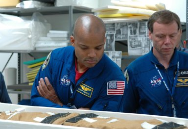 KENNEDY SPACE CENTER, FLA. - STS-116 Mission Specialists Robert Curbeam and Christer Fuglesang, who is with the European Space Agency, inspect flight hardware at the SPACEHAB Payload Processing Facility at Port Canaveral, Fla., during the Crew Equipment Interface Test. Mission crews make frequent trips to the Space Coast to become familiar with the equipment and payloads they will be using. STS-116 will be mission No. 20 to the International Space Station and construction flight 12A.1. The mission payload is the SPACEHAB module, the P5 integrated truss structure and other key components. Launch is scheduled for no earlier than Dec. 7. Photo credit: NASA/Kim Shiflett
