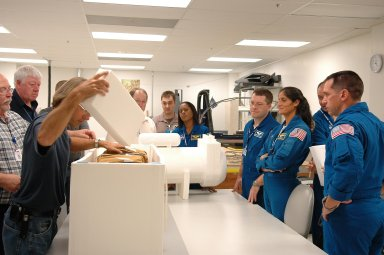 KENNEDY SPACE CENTER, FLA. - Inside the SPACEHAB Payload Processing Facility, at Port Canaveral, Fla., mission STS-116 crew members inspect flight hardware during the Crew Equipment Interface Test. From left are Mission Specialists Joan Higgenbotham, Nicholas Patrick, Sunita Williams and Christer Fuglesang, who is with the European Space Agency. Behind Fuglesang is Commander Mark Polansky. Mission crews make frequent trips to the Space Coast to become familiar with the equipment and payloads they will be using. STS-116 will be mission No. 20 to the International Space Station and construction flight 12A.1. The mission payload is the SPACEHAB module, the P5 integrated truss structure and other key components. Launch is scheduled for no earlier than Dec. 7. Photo credit: NASA/Kim Shiflett