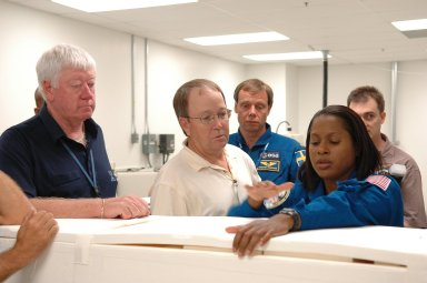 KENNEDY SPACE CENTER, FLA. - STS-116 Mission Specialists Joan Higgenbotham and Christer Fuglesang, who is with the European Space Agency, inspect flight hardware at the SPACEHAB Payload Processing Facility at Port Canaveral, Fla., during the Crew Equipment Interface Test. Mission crews make frequent trips to the Space Coast to become familiar with the equipment and payloads they will be using. STS-116 will be mission No. 20 to the International Space Station and construction flight 12A.1. The mission payload is the SPACEHAB module, the P5 integrated truss structure and other key components. Launch is scheduled for no earlier than Dec. 7. Photo credit: NASA/Kim Shiflett