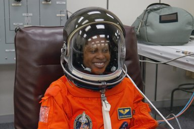 KENNEDY SPACE CENTER, FLA. -- The STS-116 mission crew practices for launch with a simulation of activities, from crew breakfast and suit-up to countdown in the orbiter. In this photo Mission Specialist Joan Higginbotham dons her launch suit and helmet before heading to Launch Pad 39B. The STS-116 mission is No. 20 to the International Space Station and construction flight 12A.1. The mission payload is the SPACEHAB module, the P5 integrated truss structure and other key components. Launch is scheduled for no earlier than Dec. 7. Photo credit: NASA/Kim Shiflett