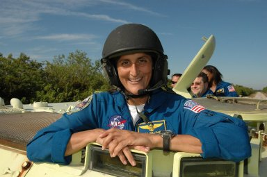 KENNEDY SPACE CENTER, FLA. -- STS-116 Mission Specialist Sunita Williams is helmeted and ready to practice driving the M-113 armored personnel carrier. The mission crew is at KSC for terminal countdown demonstration test (TCDT) activities that are preparation for launch. The M-113 could be used to move the crew quickly away from the launch pad in the event of an emergency. Behind Patrick, at right, are Pilot William Oefelein and Mission Specialists Nicholas Patrick and Joan Higginbotham. The STS-116 mission is No. 20 to the International Space Station and construction flight 12A.1. The mission payload is the SPACEHAB module, the P5 integrated truss structure and other key components. Launch is scheduled for no earlier than Dec. 7. Photo credit: NASA/Kim Shiflett