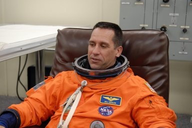 KENNEDY SPACE CENTER, FLA. -- The crew members of mission STS-116 are suiting up for launch at 9:35 p.m. EST from Launch Pad 39B aboard Space Shuttle Discovery. Pictured here is Pilot William Oefelein, who will be making his first shuttle flight. This is Discovery's 33rd mission and the first night launch since 2003. The 20th shuttle mission to the International Space Station, STS-116 carries another truss segment, P5. It will serve as a spacer, mated to the P4 truss that was attached in September. After installing the P5, the crew will reconfigure and redistribute the power generated by two pairs of U.S. solar arrays. Landing is expected Dec. 19 at KSC. Photo credit: NASA/Kim Shiflett