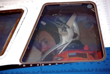 KENNEDY SPACE CENTER, FLA. -- STS-116 Pilot William Oefelein settles in the cockpit of the shuttle training aircraft (STA) before taking off for orbiter landing practice. The STA is a Grumman American Aviation-built Gulf Stream II jet that was modified to simulate an orbiter's cockpit, motion and visual cues, and handling qualities. In flight, the STA duplicates the orbiter's atmospheric descent trajectory from approximately 35,000 feet altitude to landing on a runway. Because the orbiter is unpowered during re-entry and landing, its high-speed glide must be perfectly executed the first time. Launch of Space Shuttle Discovery on mission STS-116 is scheduled for 9:35 p.m. Dec. 7. On the mission, the STS-116 crew will deliver truss segment, P5, to the International Space Station and begin the intricate process of reconfiguring and redistributing the power generated by two pairs of U.S. solar arrays. The P5 will be mated to the P4 truss that was delivered and attached during the STS-115 mission in September. Photo credit: NASA/Kim Shiflett