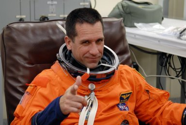 KENNEDY SPACE CENTER, FLA. -- The crew members of mission STS-116 are suiting up for a second launch attempt at 8:47 p.m. EST from Launch Pad 39B aboard Space Shuttle Discovery. Pictured here is Pilot William Oefelein, who will be making his first shuttle flight. The first launch attempt of STS-116 on Dec. 7 was postponed due a low cloud ceiling over Kennedy Space Center. This is Discovery's 33rd mission and the first night launch since 2002. The 20th shuttle mission to the International Space Station, STS-116 carries another truss segment, P5. It will serve as a spacer, mated to the P4 truss that was attached in September. After installing the P5, the crew will reconfigure and redistribute the power generated by two pairs of U.S. solar arrays. Landing is expected Dec. 19 at KSC. Photo credit: NASA/Kim Shiflett