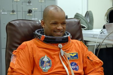 KENNEDY SPACE CENTER, FLA. -- The crew members of mission STS-116 are suiting up for a second launch attempt at 8:47 p.m. EST from Launch Pad 39B aboard Space Shuttle Discovery. Pictured here is Mission Specialist Robert Curbeam, who is making his third shuttle flight. The first launch attempt of STS-116 on Dec. 7 was postponed due a low cloud ceiling over Kennedy Space Center. This is Discovery's 33rd mission and the first night launch since 2002. The 20th shuttle mission to the International Space Station, STS-116 carries another truss segment, P5. It will serve as a spacer, mated to the P4 truss that was attached in September. After installing the P5, the crew will reconfigure and redistribute the power generated by two pairs of U.S. solar arrays. Landing is expected Dec. 19 at KSC. Photo credit: NASA/Kim Shiflett