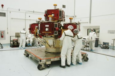 KENNEDY SPACE CENTER, FLA. -- In the Hazardous Processing Facility at Astrotech Space Operations, workers prepare the integrated THEMIS spacecraft to be moved to a spin table for spin-balance testing. THEMIS consists of five identical probes, the largest number of scientific satellites ever launched into orbit aboard a single rocket. This unique constellation of satellites will resolve the tantalizing mystery of what causes the spectacular sudden brightening of the aurora borealis and aurora australis - the fiery skies over the Earth's northern and southern polar regions. THEMIS is scheduled to launch Feb. 15 from Cape Canaveral Air Force Station. Photo credit: NASA/George Shelton