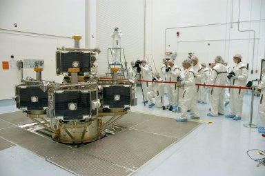 KENNEDY SPACE CENTER, FLA. -- At Astrotech Space Operations, the media are dressed in clean room, or bunny, suits to photograph the integrated THEMIS spacecraft. THEMIS consists of five identical probes, the largest number of scientific satellites ever launched into orbit aboard a single rocket. This unique constellation of satellites will resolve the tantalizing mystery of what causes the spectacular sudden brightening of the aurora borealis and aurora australis - the fiery skies over the Earth's northern and southern polar regions. THEMIS is scheduled to launch Feb. 15 from Cape Canaveral Air Force Station. Photo credit: NASA/George Shelton