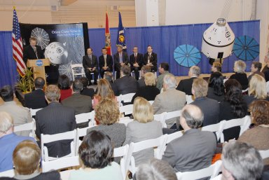 KENNEDY SPACE CENTER, FLA. -- Russell Romanella, director of the International Space Station/Payload Processing Directorate at Kennedy Space Center, addresses guests and attendees in the Operations and Checkout (O&C) Building high bay in the ceremony commemorating the bay's transition for use by the Constellation Program. Seated on the dais at right are Cleon Lacefield, Lockheed Martin program manager; Thad Altman, representative of the State of Florida; Bill Parsons, Kennedy Space Center director; Steve Koller, executive director of Space Florida; and Skip Hatfield, Orion Project manager. Originally built to process space vehicles in the Apollo era, the O&C Building will serve as the final assembly facility for the Orion crew exploration vehicle. Orion, America's human spaceflight vehicle of the future, will be capable of transporting four crewmembers for lunar missions and later will support crew transfers for Mars missions. Each Orion spacecraft also may be used to support up to six crewmembers to the International Space Station after the space shuttle is retired in 2010. Design, development and construction of Orion's components will be performed by Lockheed Martin for NASA at facilities throughout the country. Photo credit: NASA/Kim Shiflett