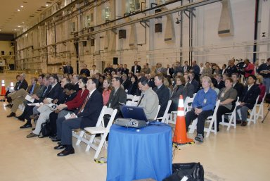 KENNEDY SPACE CENTER, FLA. -- Employees and guests are seated in the Operations and Checkout (O&C) Building high bay for the ceremony commemorating the bay's transition for use by the Constellation Program. Originally built to process space vehicles in the Apollo era, the O&C Building will serve as the final assembly facility for the Orion crew exploration vehicle. Orion, America's human spaceflight vehicle of the future, will be capable of transporting four crewmembers for lunar missions and later will support crew transfers for Mars missions. Each Orion spacecraft also may be used to support up to six crewmembers to the International Space Station after the space shuttle is retired in 2010. Design, development and construction of Orion's components will be performed by Lockheed Martin for NASA at facilities throughout the country. Photo credit: NASA/Kim Shiflett