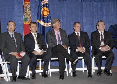 KENNEDY SPACE CENTER, FLA. -- Representatives from NASA, Lockheed Martin, Space Florida and the state of Florida are seated on stage at a ceremony to commemorate the transition of the historic Operations and Checkout (O&C) Building high bay for use by the Constellation Program. From left are Cleon Lacefield, Lockheed Martin program manager; Thad Altman, representative of the State of Florida; Bill Parsons, Kennedy Space Center director; Steve Koller, executive director of Space Florida; and Skip Hatfield, Orion Project manager. Representatives from NASA, Lockheed Martin, Space Florida and the state of Florida are seated on stage at a ceremony to commemorate the transition of the historic Operations and Checkout (O&C) Building high bay for use by the Constellation Program. From left are Cleon Lacefield, Lockheed Martin program manager; Thad Altman, representative of the State of Florida; Bill Parsons, Kennedy Space Center director; Steve Koller, executive director of Space Florida; and Skip Hatfield, Orion Project manager. Originally built to process space vehicles in the Apollo era, the O&C Building will serve as the final assembly facility for the Orion crew exploration vehicle. Orion, America's human spaceflight vehicle of the future, will be capable of transporting four crewmembers for lunar missions and later will support crew transfers for Mars missions. Each Orion spacecraft also may be used to support up to six crewmembers to the International Space Station after the space shuttle is retired in 2010. Design, development and construction of Orion's components will be performed by Lockheed Martin for NASA at facilities throughout the country. Photo credit: NASA/Kim Shiflett