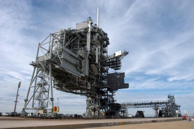 KENNEDY SPACE CENTER, FLA. -- The rotating service structure on Launch Pad 39A has moved for the first time in more than a year due to maintenance and upgrades on the pad. Some of the work included sandblasting the structure to remove rust and repainting. In addition, the RSS was jacked up and a new upper-bearing race assembly installed where the RSS pivots against the fixed service structure and a half-inch steel plate added. Pad 39A is being made ready for its first launch in four years, the upcoming STS-117 on March 15. Photo credit: NASA/George Shelton