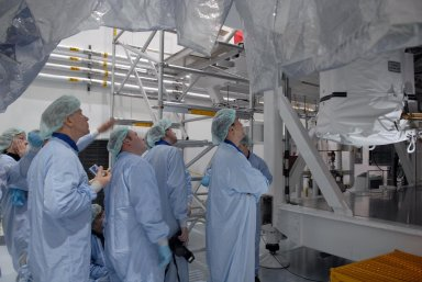 KENNEDY SPACE CENTER, FLA. -- In the Space Station Processing Facility, astronauts peer up into the stands holding the Node 2 module. Visible from left are Sandra Magnuson, Tim Kopra, Michael Fincke, Frank DeWinne and Soichi Noguchi. They and other astronauts are familiarizing themselves with the various elements to be installed on the International Space Station on future spaceflights. With construction of the Space Station the primary focus of future shuttle missions, astronaut crews will be working with one or more of the elements and hardware already being processed in the SSPF. Photo credit: NASA/Kim Shiflett