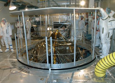 KENNEDY SPACE CENTER, FLA. -- Inside the mobile service tower on Launch Pad 17-B at Cape Canaveral Air Force Station, workers erect a protective screen above the THEMIS spacecraft to preserve a clean-room environment. THEMIS consists of five identical probes, the largest number of scientific satellites ever launched into orbit aboard a single rocket. The THEMIS mission is to investigate what causes auroras in the Earth's atmosphere to dramatically change from slowly shimmering waves of light to wildly shifting streaks of color. Discovering what causes auroras to change will provide scientists with important details on how the planet's magnetosphere works and the important Sun-Earth connection. THEMIS is scheduled to launch aboard a Delta II rocket on Feb. 15 during a window extending from 6:08 to 6:27 p.m. Photo credit: NASA/Amanda Diller