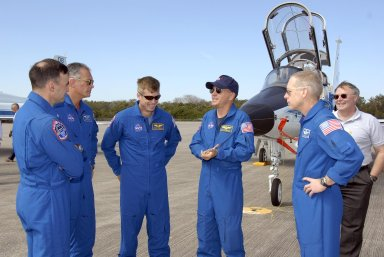 KENNEDY SPACE CENTER, FLA. -- The STS-117 crew arrives at NASA's Kennedy Space Center to take part in the Terminal Countdown Demonstration Test (TCDT), a preparation for the launch March 15 to the International Space Station. From left are Pilot Lee Archambault, Mission Specialists Danny Olivas and Steven Swanson, Commander Rick Sturckow, and Mission Specialist Patrick Forrester. The TCDT includes emergency egress training and a simulated launch countdown. The mission payload aboard Space Shuttle Atlantis is the S3/S4 integrated truss structure, along with a third set of solar arrays and batteries. The crew of six astronauts will install the truss to continue assembly of the station. Photo credit: NASA/Kim Shiflett