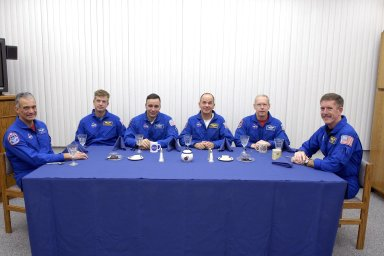 KENNEDY SPACE CENTER, FLA. -- In the crew quarters at the Operations and Checkout Building, the Mission STS-117 crew members enjoy breakfast before resuming Terminal Countdown Demonstration Test activities. From left are Mission Specialists Danny Olivas and Steven Swanson, Pilot Lee Archambault, Commander Rick Sturckow and Mission Specialists Patrick Forrester and James Reilly. The TCDT also includes M-113 armored personnel carrier training, pad emergency egress training and a simulated launch countdown. The mission payload aboard Space Shuttle Atlantis is the S3/S4 integrated truss structure, along with a third set of solar arrays and batteries. The crew of six astronauts will install the truss to continue assembly of the International Space Station. Photo credit: NASA/Kim Shiflett.