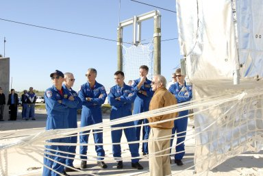 KENNEDY SPACE CENTER, FLA. -- In the Launch Pad 39A area, Mission STS-117 crew members receive instruction on emergency egress using the slidewire basket system during Terminal Countdown Demonstration Test activities. From left are Commander Rick Sturckow, Mission Specialists Patrick Forrester and Danny Olivas, Pilot Lee Archambault, and Mission Specialists James Reilly and Steven Swanson. The TCDT also includes M-113 armored personnel carrier training, and a simulated launch countdown. The mission payload aboard Space Shuttle Atlantis is the S3/S4 integrated truss structure, along with a third set of solar arrays and batteries. The crew of six astronauts will install the truss to continue assembly of the International Space Station. Photo credit: NASA/Kim Shiflett