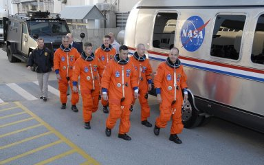 KENNEDY SPACE CENTER, FLA. -- Dressed in their flights suits, the Mission STS-117 crew members practice walk out from the Operations and Checkout Building to the astronaut van for transport to Launch Pad 39A during terminal countdown demonstration test activities. From the left are Mission Specialists Danny Olivas, Steven Swanson and James Reilly (behind Swanson), Pilot Lee Archambault, Mission Specialist Patrick Forrester, and Commander Rick Sturckow is leading the way. The STS-117 mission is No. 21 to the International Space Station. Mission payloads aboard Atlantis include the S3/S4 integrated truss structure, a third set of solar arrays and batteries. The crew of six astronauts will install the truss to continue assembly of the station. Launch is scheduled for no earlier than March 15. Photo credit: NASA/Kim Shiflett.