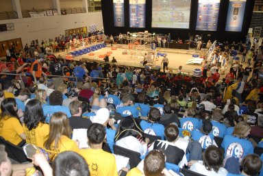 """KENNEDY SPACE CENTER, FLA. -- The audience anxiously awaits a referee's decision during competition of student teams in the FIRST robotics event held at the University of Central Florida Arena March 8-10. The FIRST, or For Inspiration and Recognition of Science and Technology, Robotics Competition challenges teams of young people and their mentors to solve a common problem in a six-week timeframe using a standard """"kit of parts"""" and a common set of rules. Teams build robots from the parts and enter them in a series of competitions designed by FIRST founder Dean Kamen and Dr. Woodie Flowers, chairman and vice chairman of the Executive Advisory Board respectively, and a committee of engineers and other professionals. FIRST redefines winning for these students. Teams are rewarded for excellence in design, demonstrated team spirit, gracious professionalism and maturity, and ability to overcome obstacles. Scoring the most points is a secondary goal. Winning means building partnerships that last. Photo credit: NASA/Kim Shiflett"""