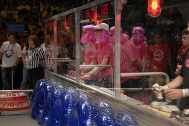 """KENNEDY SPACE CENTER, FLA. -- The student team no. 233 dressed in pink controls its robot during competition in the FIRST robotics event held at the University of Central Florida Arena March 8-10. The team is a coordinated effort co-sponsored by NASA KSC and representing Rockledge, Cocoa Beach and Viera High Schools in Central Florida. The FIRST, or For Inspiration and Recognition of Science and Technology, Robotics Competition challenges teams of young people and their mentors to solve a common problem in a six-week timeframe using a standard """"kit of parts"""" and a common set of rules. Teams build robots from the parts and enter them in a series of competitions designed by FIRST founder Dean Kamen and Dr. Woodie Flowers, chairman and vice chairman of the Executive Advisory Board respectively, and a committee of engineers and other professionals. FIRST redefines winning for these students. Teams are rewarded for excellence in design, demonstrated team spirit, gracious professionalism and maturity, and ability to overcome obstacles. Scoring the most points is a secondary goal. Winning means building partnerships that last. Photo credit: NASA/Kim Shiflett"""