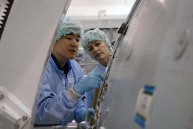 KENNEDY SPACE CENTER, FLA. -- In the Space Station Processing Facility, STS-120 Mission Specialist Daniel Tani (left) examines equipment for the Node 2, another element to be added to the International Space Station. Looking on, at right, is astronaut Peggy Whitson, who served on Expedition 5 aboard the space station. During her 6-month stay aboard the space station, Dr. Whitson installed the Mobile Base System, the S1 truss segment, and the P1 truss segment. Tani and other crew members are at KSC for equipment familiarization. Tani will be joining the Expedition 15 crew on the space station as flight engineer. Node 2 will provide a passageway between three station science experiment facilities: the U.S. Destiny Laboratory, the Kibo Japanese Experiment Module, and the European Columbus Laboratory. STS-120 is targeted for launch on October 20. Photo credit: NASA/Kim Shiflett
