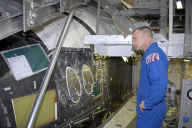 KENNEDY SPACE CENTER, FLA. -- During crew equipment interface test activities, members of the STS-118 crew look over the orbiter Endeavour in Orbiter Processing Facility bay 2. Seen here is Pilot Charles Hobaugh looking at the cockpit area. The STS-118 mission will be delivering the third starboard truss segment, the ITS S5, to the International Space Station, as well as the SPACEHAB single cargo module filled with supplies and equipment. Launch aboard Space Shuttle Endeavour is targeted for Aug. 9. Photo credit: NASA/Kim Shiflett