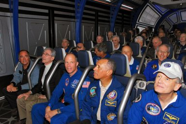 KENNEDY SPACE CENTER, FLA. -- Former astronauts take their seats in the newest attraction at Kennedy Space Center's Visitor Complex, the Shuttle Launch Experience. In the front row are (from left) Bob Crippen, John Young, Rick Searfoss, Charles Bolden and Norm Thagard. The attraction includes a simulated launch with the sights, sounds and sensations of launching into space. Find out more about the Visitor Complex and the Shuttle Launch Experience at *http://www.kennedyspacecenter.com/visitKSC/attractions/index.asp*. Photo credit: NASA/George Shelton