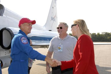 KENNEDY SPACE CENTER, FLA. -- The STS-117 crew members arrive at the KSC Shuttle Landing Facility aboard T-38 jet aircraft to prepare for launch on Space Shuttle Atlantis on June 8. Commander Frederick Sturckow is greeted by Janet Petro, deputy director of Kennedy. Astronaut Jerry Ross, chief of the Vehicle Integration Test Office at Johnson Space Center, looks on. During the 11-day mission and three spacewalks, the crew will work with flight controllers at NASA's Johnson Space Center in Houston to install a 17-ton segment on the station's girder-like truss and deploy a set of solar arrays, S3/S4. The mission will increase the space station's power capability in preparation for the arrival of new science modules from the European and Japanese space agencies. Photo credit: NASA/Kim Shiflett