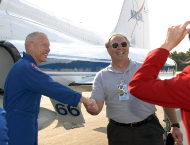 KENNEDY SPACE CENTER, FLA. -- The STS-117 crew members arrive at the KSC Shuttle Landing Facility aboard T-38 jet aircraft to prepare for launch on Space Shuttle Atlantis on June 8. Mission Specialist Patrick Forrester is welcomed by astronaut Jerry Ross, chief of the Vehicle Integration Test Office at Johnson Space Center. During the 11-day mission and three spacewalks, the crew will work with flight controllers at NASA's Johnson Space Center in Houston to install a 17-ton segment on the station's girder-like truss and deploy a set of solar arrays, S3/S4. The mission will increase the space station's power capability in preparation for the arrival of new science modules from the European and Japanese space agencies. Photo credit: NASA/Kim Shiflett
