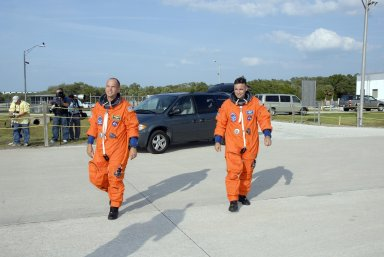 KENNEDY SPACE CENTER, FLA. -- STS-117 Commander Frederick Sturckow (left) and Pilot Lee Archambault head for the shuttle training aircraft, or STA, at KSC's Shuttle Landing Facility. They will be making practice landings in the STA, which is a Grumman American Aviation-built Gulf Stream II jet that was modified to simulate an orbiter's cockpit, motion and visual cues, and handling qualities. In flight, the STA duplicates the orbiter's atmospheric descent trajectory from approximately 35,000 feet altitude to landing on a runway. STS-117 is scheduled to launch at 7:38 p.m. June 8. During the 11-day mission and three spacewalks, the crew will work with flight controllers at NASA's Johnson Space Center in Houston to install the 17-ton segment on the station's girder-like truss and deploy the set of solar arrays, S3/S4. The mission will increase the space station's power capability in preparation for the arrival of new science modules from the European and Japanese space agencies. Photo credit: NASA/Kim Shiflett