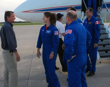 KENNEDY SPACE CENTER, Fla. -- The STS-118 crew arrives at Kennedy's Shuttle Landing Facility aboard a Shuttle Training Aircraft to take part in the Terminal Countdown Demonstration Test (TCDT), a dress rehearsal for launch. Shuttle Launch Director Mike Leinbach (left) welcomes Mission Specialists Tracy Caldwell, Rick Mastracchio and Dave Williams of the Canadian Space Agency, as Commander Scott Kelly (back to camera) looks on. TCDT activities include M-113 armored personnel carrier training, payload familiarization, emergency egress training at the pad and a simulated launch countdown. The STS-118 payload aboard Space Shuttle Endeavour includes the S5 truss, a SPACEHAB module and external stowage platform 3. The mission is the 22nd flight to the International Space Station and is targeted for launch on Aug.7. Photo credit: NASA/George Shelton