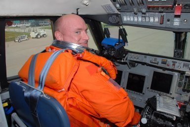 KENNEDY SPACE CENTER, Fla. -- STS-118 Commander Scott Kelly settles in his cockpit seat aboard the shuttle training aircraft, known as an STA, for landing practice. The practice is part of Terminal Countdown Demonstration Test, or TCDT, activities that include a simulated launch countdown. The STA is a Grumman American Aviation-built Gulf Stream II jet that was modified to simulate an orbiter's cockpit, motion and visual cues, and handling qualities. In flight, the STA duplicates the orbiter's atmospheric descent trajectory from approximately 35,000 feet altitude to landing on a runway. The STS-118 mission is the 22nd flight to the International Space Station and is targeted for launch on Aug. 7. The mission payload aboard Space Shuttle Endeavour includes the S5 truss, a SPACEHAB module and external stowage platform 3. NASA/George Shelton