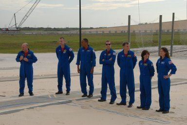 KENNEDY SPACE CENTER, Fla. -- On the slidewire basket bunker area of Launch Pad 39A, the STS-118 crew talks to the media before the crew's morning training activities in the terminal countdown demonstration test, or TCDT. At left is Commander Scott Kelly, with the microphone. The others, from left, are Pilot Charlie Hobaugh and Mission Specialists Alvin Drew, Rick Mastracchio, Dave Williams, Barbara R. Morgan and Tracy Caldwell. Williams represents the Canadian Space Agency. Morgan joined NASA's Teacher in Space program in 1985 and was selected as an astronaut in 1998. TCDT activities include M-113 training, payload familiarization, the emergency egress training at the pad and a simulated launch countdown. The mission is the 22nd flight to the International Space Station and Space Shuttle Endeavour will carry a payload including the S5 truss, a SPACEHAB module and external stowage platform 3. STS-118 is targeted for launch on Aug. 7. NASA/George Shelton