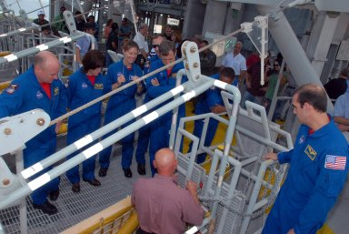 KENNEDY SPACE CENTER, Fla. -- On an upper level of the Pad 39A fixed service structure, the STS-118 crew members look at the slidewire basket that is part of the emergency egress system. On the left are Commander Scott Kelly and Mission Specialists Barbara R. Morgan, Tracy Caldwell, Dave Williams and Alvin Drew. On the right is Mission Specialist Rick Mastracchio. Morgan joined NASA's Teacher in Space program in 1985 and was selected as an astronaut in 1998. Williams represents the Canadian Space Agency. The crew is at Kennedy for training activities in the terminal countdown demonstration test, or TCDT. TCDT activities include M-113 training, payload familiarization, the emergency egress training at the pad and a simulated launch countdown. The mission is the 22nd flight to the International Space Station and Space Shuttle Endeavour will carry a payload including the S5 truss, a SPACEHAB module and external stowage platform 3. STS-118 is targeted for launch on Aug. 7. NASA/George Shelton