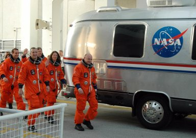 KENNEDY SPACE CENTER, Fla. -- The STS-118 crew walks toward the Astrovan that will take them to Launch Pad 39A for a simulated launch countdown. From left are Mission Specialists Barbara R. Morgan and Rick Mastracchio, Pilot Charlie Hobaugh, Mission Specialists Dave Williams and Tracy Caldwell, and Commander Scott Kelly. Morgan joined NASA's Teacher in Space program in 1985 and was selected as an astronaut in 1998. The countdown concludes the terminal countdown demonstration test, or TCDT. The STS-118 crew has been at Kennedy for the TCDT activities that also include M-113 training, payload familiarization and emergency egress training at the pad. The mission is the 22nd flight to the International Space Station and Space Shuttle Endeavour will carry a payload including the S5 truss, a SPACEHAB module and external stowage platform 3. STS-118 is targeted for launch on Aug. 7. Photo credit: NASA/George Shelton