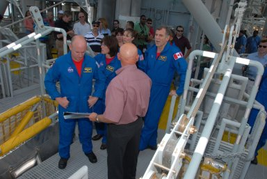 KENNEDY SPACE CENTER, Fla. -- On an upper level of the Pad 39A fixed service structure, the STS-118 crew get instructions from a trainer about using the emergency egress system. The crew members seen here are, from left, Commander Scott Kelly and Mission Specialists Barbara R. Morgan, Tracy Caldwell and Dave Williams. Morgan joined NASA's Teacher in Space program in 1985 and was selected as an astronaut in 1998. Williams represents the Canadian Space Agency. The crew is at Kennedy for training activities in the terminal countdown demonstration test, or TCDT. TCDT activities include M-113 training, payload familiarization, the emergency egress training at the pad and a simulated launch countdown. The mission is the 22nd flight to the International Space Station and Space Shuttle Endeavour will carry a payload including the S5 truss, a SPACEHAB module and external stowage platform 3. STS-118 is targeted for launch on Aug. 7. NASA/George Shelton