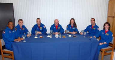 KENNEDY SPACE CENTER, Fla. -- Members of the STS-118 crew enjoy breakfast together before the next event in their Terminal Countdown Demonstration Test (TCDT), a dress rehearsal for launch. Following the meal, the crew will don their flight suits and board Space Shuttle Endeavour for a simulated countdown. From left are Mission Specialists Alvin Drew and the Canadian Space Agency's Dave Williams, Pilot Charlie Hobaugh, Commander Scott Kelly, and Mission Specialists Tracy Caldwell, Rick Mastracchio and teacher-turned-astronaut Barbara R. Morgan. TCDT activities also include M-113 armored personnel carrier training, payload familiarization, and emergency egress training at the pad. The STS-118 payload includes the S5 truss, a SPACEHAB module and external stowage platform 3. The mission is the 22nd flight to the International Space Station and is targeted for launch on Aug.7. Photo credit: NASA/George Shelton