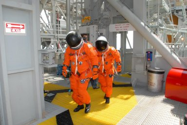 KENNEDY SPACE CENTER, Fla. -- Practicing emergency egress from Launch Pad 39A, STS-118 crew members head for the slidewire basket area. They are taking part in terminal countdown demonstration test activities that included a simulated launch countdown. The crew comprises Commander Scott Kelly, Pilot Charlie Hobaugh and Mission Specialists Dave Williams, Barbara R. Morgan, Rick Mastracchio, Tracy Caldwell and Alvin Drew. Williams represents the Canadian Space Agency. Morgan joined NASA's Teacher in Space program in 1985 and was selected as an astronaut in 1998. The STS-118 mission on Space Shuttle Endeavour is the 22nd flight to the International Space Station and will carry a payload including the S5 truss, a SPACEHAB module and external stowage platform 3. STS-118 is targeted for launch on Aug. 7. Photo credit: NASA/George Shelton
