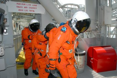 KENNEDY SPACE CENTER, Fla. -- Practicing emergency egress from Launch Pad 39A, STS-118 crew members head for the slidewire basket area. They are taking part in terminal countdown demonstration test activities that included a simulated launch countdown. The crew comprises Commander Scott Kelly, Pilot Charlie Hobaugh and Mission Specialists Dave Williams, Barbara R. Morgan, Rick Mastracchio, Tracy Caldwell and Alvin Drew. Williams represents the Canadian Space Agency. Morgan joined NASA's Teacher in Space program in 1985 and was selected as an astronaut in 1998. The STS-118 mission on Space Shuttle Endeavour is the 22nd flight to the International Space Station and will carry a payload including the S5 truss, a SPACEHAB module and external stowage platform 3. STS-118 is targeted for launch on Aug. 7. NASA/George Shelton