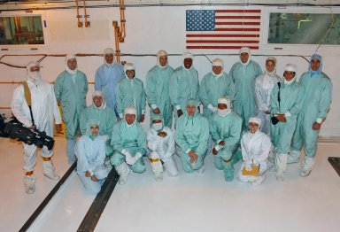KENNEDY SPACE CENTER, FLA. -- The STS-118 crew breaks for a photo with the Endeavour team and key personnel during payload familiarization. Kneeling in front are Eve Stavros, Boeing flow manager for the mission; Dave Brashinger, with NASA; Paul Boehm, EVA trainer; S. Adam Niev, with NASA Electrical; Louise Kleba, with the KSC payload VITT office; Lance Rogers, a NASA summer co-op; and Jackie Kagey, an EVA trainer. Standing in the back, from left, are photographer Cory Huston; Darren Welsh, EVA trainer; Jack Keifenheim, with NASA Engineering; Mission Specialist Barbara R. Morgan, Pilot Charlie Hobaugh, Mission Specialist Alvin Drew, Commander Scott Kelly, and Mission Specialists Dave Williams and Tracy Caldwell, Lisa Alonso, a NASA summer intern; and (far right) Mission Specialist Rick Mastracchio. Morgan joined NASA's Teacher in Space program in 1985 and was selected as an astronaut in 1998. Williams represents the Canadian Space Agency. The 22nd shuttle flight to the International Space Station, the STS-118 mission will continue space station construction by delivering a third starboard truss segment, S5, and other payloads such as the SPACEHAB module and the external stowage platform 3. Photo credit: NASA/George Shelton