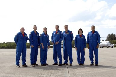 KENNEDY SPACE CENTER, FLA. -- The STS-118 crew arrives at Kennedy Space Center's Shuttle Landing Facility to prepare for launch on Aug. 8 aboard Space Shuttle Endeavour. From left are Commander Scott Kelly, Pilot Charlie Hobaugh, and Mission Specialists Tracy Caldwell, Rick Mastracchio, Dave Williams (with the Canadian Space Agency), Barbara Morgan and Alvin Drew. Endeavour's STS-118 mission is the 22nd shuttle flight to the International Space Station. It will continue space station construction by delivering a third starboard truss segment, S5. Other payloads include the SPACEHAB module, making its last voyage, and the external stowage platform 3 with a control moment gyroscope on it. The flight will include at least three spacewalks. The crew will also debut a new system that enables docked shuttles to draw electrical power from the station to extend visits to the outpost. Photo credit: NASA/Kim Shiflett