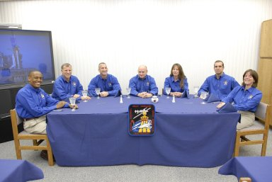 KENNEDY SPACE CENTER, FLA. -- The STS-118 crew enjoys a traditional meal before suiting up for launch. Seated left to right are Mission Specialists Alvin Drew and Dave Williams, Pilot Charlie Hobaugh, Commander Scott Kelly, and Mission Specialists Tracy Caldwell, Rick Mastracchio and Barbara R. Morgan, the teacher-turned-astronaut. Space Shuttle Endeavour's STS-118 mission is the 22nd shuttle flight to the International Space Station. It will continue space station construction by delivering a third starboard truss segment, S5, and other payloads such as the SPACEHAB module and the external stowage platform 3. The 11-day mission may be extended to as many as 14 depending on the test of the Station-to-Shuttle Power Transfer System that will allow the docked shuttle to draw electrical power from the station and extend its visits to the orbiting lab. NASA/Kim Shiflett