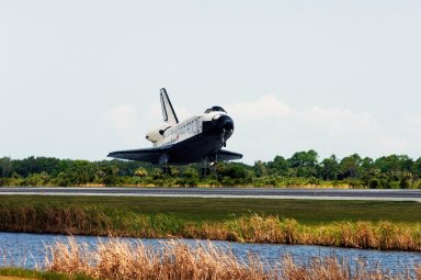 KENNEDY SPACE CENTER, FLA. -- Endeavour approaches touchdown on runway 15 at NASA's Kennedy Space Center after traveling nearly 5.3 million miles on mission STS-118. The Space Shuttle Endeavour crew, led by Commander Scott Kelly, completes a 13-day mission to the International Space Station. The STS-118 mission began Aug. 8 and installed a new gyroscope, an external spare parts platform and another truss segment to the expanding station. Endeavour's main gear touched down at 12:32:16 p.m. EDT. Nose gear touchdown was at 12:32:29 p.m. and wheel stop was at 12:33:20 p.m. Endeavour landed on orbit 201. STS-118 was the 119th space shuttle flight, the 22nd flight to the station, the 20th flight for Endeavour and the second of four missions planned for 2007. This was the 65th landing of an orbiter at Kennedy. Photo credit: NASA/Rafael Hernandez