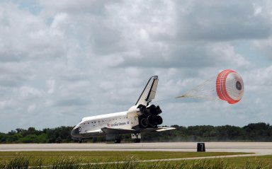 KENNEDY SPACE CENTER, FLA. -- The open drag chute helps slow Endeavour as it lands on runway 15 at NASA's Kennedy Space Center. The Space Shuttle Endeavour crew, led by Commander Scott Kelly, completes a 13-day mission to the International Space Station. The STS-118 mission began Aug. 8 and installed a new gyroscope, an external spare parts platform and another truss segment to the expanding station. Endeavour's main gear touched down at 12:32:16 p.m. EDT. Nose gear touchdown was at 12:32:29 p.m. and wheel stop was at 12:33:20 p.m. Endeavour traveled nearly 5.3 million miles, landing on orbit 201. This was the 65th landing of an orbiter at Kennedy. Photo credit: NASA/George Shelton