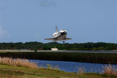 KENNEDY SPACE CENTER, FLA. -- With landing wheels down, Endeavour glides toward a landing on runway 15 at NASA's Kennedy Space Center after traveling nearly 5.3 million miles on mission STS-118. The Space Shuttle Endeavour crew, led by Commander Scott Kelly, completes a 13-day mission to the International Space Station. The STS-118 mission began Aug. 8 and installed a new gyroscope, an external spare parts platform and another truss segment to the expanding station. Endeavour's main gear touched down at 12:32:16 p.m. EDT. Nose gear touchdown was at 12:32:29 p.m. and wheel stop was at 12:33:20 p.m. Endeavour landed on orbit 201. STS-118 was the 119th space shuttle flight, the 22nd flight to the station, the 20th flight for Endeavour and the second of four missions planned for 2007. This was the 65th landing of an orbiter at Kennedy. Photo credit: NASA/Rafael Hernandez