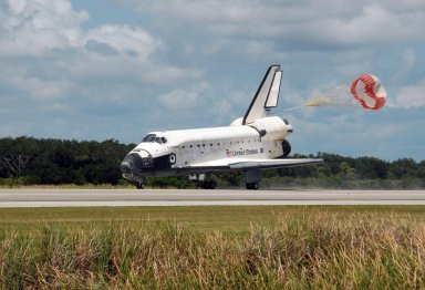 KENNEDY SPACE CENTER, FLA. -- The opening drag chute helps slow Endeavour as it lands on runway 15 at NASA's Kennedy Space Center. The Space Shuttle Endeavour crew, led by Commander Scott Kelly, completes a 13-day mission to the International Space Station. The STS-118 mission began Aug. 8 and installed a new gyroscope, an external spare parts platform and another truss segment to the expanding station. Endeavour's main gear touched down at 12:32:16 p.m. EDT. Nose gear touchdown was at 12:32:29 p.m. and wheel stop was at 12:33:20 p.m. Endeavour traveled nearly 5.3 million miles, landing on orbit 201. STS-118 was the 119th space shuttle flight, the 22nd flight to the station, the 20th flight for Endeavour and the second of four missions planned for 2007. This was the 65th landing of an orbiter at Kennedy. Photo credit: NASA/George Shelton