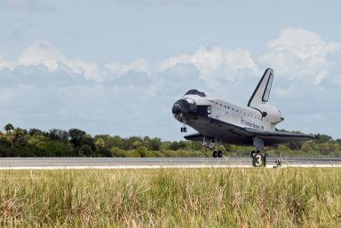 KENNEDY SPACE CENTER, FLA. -- Endeavour touches down on runway 15 at NASA's Kennedy Space Center as after traveling nearly 5.3 million miles on mission STS-118. The Space Shuttle Endeavour crew, led by Commander Scott Kelly, completes a 13-day mission to the International Space Station. The STS-118 mission began Aug. 8 and installed a new gyroscope, an external spare parts platform and another truss segment to the expanding station. Endeavour's main gear touched down at 12:32:16 p.m. EDT. Nose gear touchdown was at 12:32:29 p.m. and wheel stop was at 12:33:20 p.m. Endeavour landed on orbit 201. STS-118 was the 119th space shuttle flight, the 22nd flight to the station, the 20th flight for Endeavour and the second of four missions planned for 2007. This was the 65th landing of an orbiter at Kennedy. Photo credit: NASA/Chuck Tintera