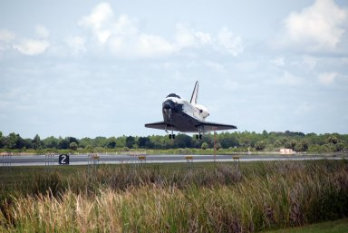 KENNEDY SPACE CENTER, FLA. -- Endeavour approaches touchdown on runway 15 at NASA's Kennedy Space Center. The Space Shuttle Endeavour crew, led by Commander Scott Kelly, completes a 13-day mission to the International Space Station. The STS-118 mission began Aug. 8 and installed a new gyroscope, an external spare parts platform and another truss segment to the expanding station. Endeavour's main gear touched down at 12:32:16 p.m. EDT. Nose gear touchdown was at 12:32:29 p.m. and wheel stop was at 12:33:20 p.m. Endeavour traveled nearly 5.3 million miles, landing on orbit 201. STS-118 was the 119th space shuttle flight, the 22nd flight to the station, the 20th flight for Endeavour and the second of four missions planned for 2007. This was the 65th landing of an orbiter at Kennedy. Photo credit: NASA/Kim Shiflett