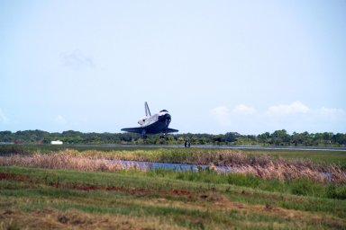 KENNEDY SPACE CENTER, FLA. -- After traveling nearly 5.3 million miles on mission STS-118, Endeavour is close to landing on runway 15 at NASA's Kennedy Space Center. The Space Shuttle Endeavour crew, led by Commander Scott Kelly, completes a 13-day mission to the International Space Station. The STS-118 mission began Aug. 8 and installed a new gyroscope, an external spare parts platform and another truss segment to the expanding station. Endeavour's main gear touched down at 12:32:16 p.m. EDT. Nose gear touchdown was at 12:32:29 p.m. and wheel stop was at 12:33:20 p.m. Endeavour landed on orbit 201. STS-118 was the 119th space shuttle flight, the 22nd flight to the station, the 20th flight for Endeavour and the second of four missions planned for 2007. This was the 65th landing of an orbiter at Kennedy. Photo credit: NASA/Scott Haun