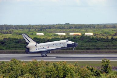 KENNEDY SPACE CENTER, FLA. -- Endeavour rolls down runway 15 at NASA's Kennedy Space Center after traveling nearly 5.3 million miles on mission STS-118. The Space Shuttle Endeavour crew, led by Commander Scott Kelly, completes a 13-day mission to the International Space Station. The STS-118 mission began Aug. 8 and installed a new gyroscope, an external spare parts platform and another truss segment to the expanding station. Endeavour's main gear touched down at 12:32:16 p.m. EDT. Nose gear touchdown was at 12:32:29 p.m. and wheel stop was at 12:33:20 p.m. Endeavour landed on orbit 201. STS-118 was the 119th space shuttle flight, the 22nd flight to the station, the 20th flight for Endeavour and the second of four missions planned for 2007. This was the 65th landing of an orbiter at Kennedy. Photo credit: NASA/Ken Thornsley